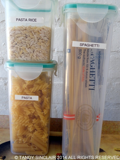 Pasta Stocking A Pantry With Container Items