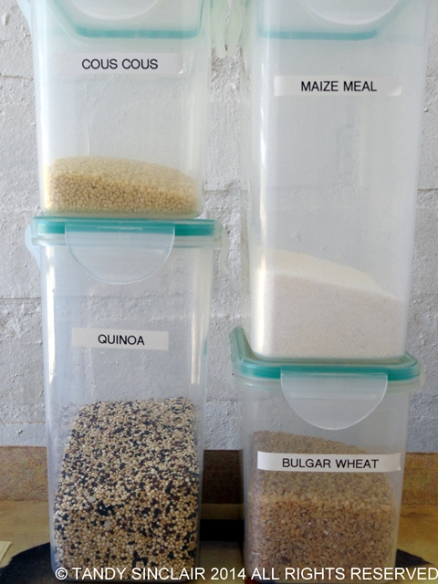 Quinoa Cous Cous Maize and Bulgar Stocking A Pantry With Container Items