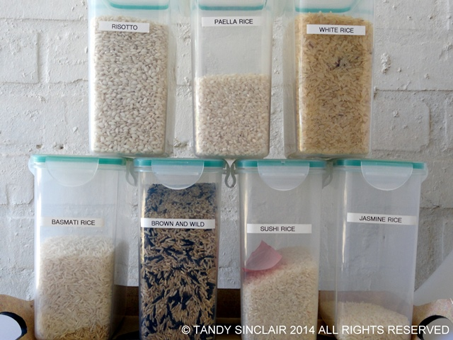 Rice Stocking A Pantry With Container Items