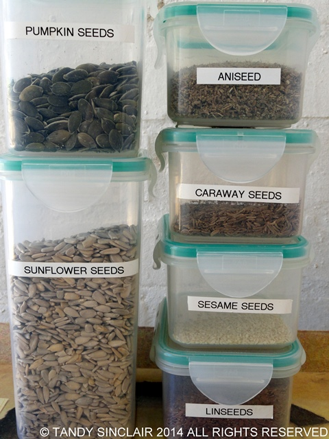 Seeds Stocking A Pantry With Container Items