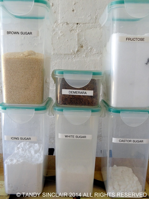 Sugar and Fructose Stocking A Pantry With Container Items